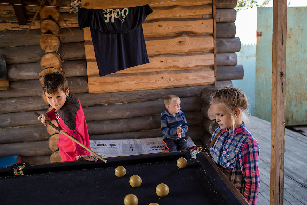 Kids, part of a group of internally displaced people who fled the besieged city of Donetsk and are now living in a small seaside resort, play on Tuesday, October 14, 2014 in Berdyansk, Ukraine. Photo by Brendan Hoffman, Freelance
