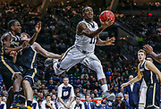 SOUTH BEND, IN - NOVEMBER 17: Demetrius Jackson #11 of the Notre Dame Fighting Irish shoots the ball under the basket against the Milwaukee Panthers at Purcell Pavilion on November 17, 2015 in South Bend, Indiana.