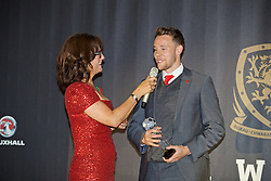 CARDIFF, WALES - Tuesday, November 8, 2016: Wales' Chris Gunter interviewed by host Francis Donovan after being awarded the Media Choice award during the FAW Awards Dinner at the Vale Resort. (Pic by David Rawcliffe/Propaganda)