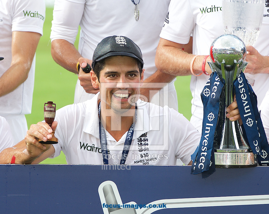 Captain Alastair Cook of England holds the Ashes Urn and the trophy after winning the Ashes series the 5th Investec Ashes Test match at the Kia Oval, London<br /> Picture by Alan Stanford/Focus Images Ltd +44 7915 056117<br /> 23/08/2015