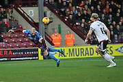 Neil Bishop of Scunthorpe United makes lunging header at ball  during the Sky Bet League 1 match between Scunthorpe United and Sheffield Utd at Glanford Park, Scunthorpe, England on 19 December 2015. Photo by Ian Lyall.