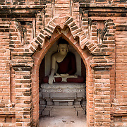 BAGAN, Myanmar (Burma) - A small pagoda in Bagan, with a statue of the Buddha. Capital of the ancient Kingdom of Pagan, Bagan features thousands of temples and pagodas, some of which date back to the 9th century.