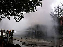 61139412<br /> Photo taken with a mobile phone on Feb. 27, 2014 shows firefighters extinguishing bus fire in Guiyang, capital of southwest China s Guizhou Province. A bus bursted into flames on Jinyang South Road in Guiyang on Thursday, leaving five people dead so far, Thursday, 27th February 2014. Picture by  imago / i-Images<br /> UK ONLY