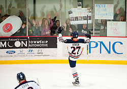 March 13 2016: Robert Morris Colonials forward Zac Lynch (27) celebrates after scoring a goal during the second period in game three of the Atlantic Hockey quarterfinals series between the Bentley Falcons and the Robert Morris Colonials at the 84 Lumber Arena in Neville Island, Pennsylvania (Photo by Justin Berl)