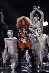 Little Mix's Leigh-Anne Pinnock performing on stage at the Brit Awards at the O2 Arena, London.