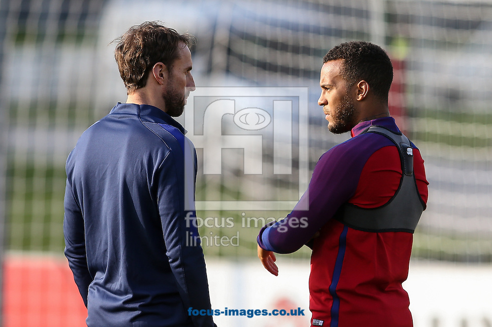 Gareth Southgate, caretaker England manager, chats with Ryan Bertrand (Southampton) during the England training session at St Georges Park, Burton upon Trent<br /> Picture by Andy Kearns/Focus Images Ltd 0781 864 4264<br /> 04/10/2016
