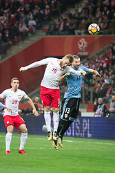 November 10, 2017 - Warsaw, Poland - Jakub Blaszczykowski (16) and Gaston Silva (13) during the international friendly soccer match between Poland and Uruguay at the PGE National Stadium in Warsaw, Poland on 10 November 2017  (Credit Image: © Mateusz Wlodarczyk/NurPhoto via ZUMA Press)