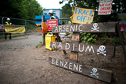 © London News Pictures. 16/08/2013. Balcombe, UK. A sign at the entrance to the Cuadrilla drilling site in Balcombe, West Sussex which has been earmarked for fracking. Cuadrilla has temporarily ceased drilling at the site under advice from the police after campaign group No Dash For Gas threatened a weekend of civil disobedience. Photo credit: Ben Cawthra/LNP