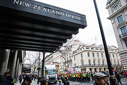 London, UK. 16th March, 2019. Thousands of people  on the March Against Racism demonstration on UN Anti-Racism Day pause outside the New Zealand High Commission for a minute's silence for the 49 people killed and 48 injured during a terror attack yesterday on two mosques in New Zealand by a far-right extremist.