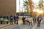 Electioneers campaign outside of the Frederick H. Tuttle Middle School polling location in South Burlington on Tuesday morning. Photographer in Burlington VT, Oliver Parini Photography.