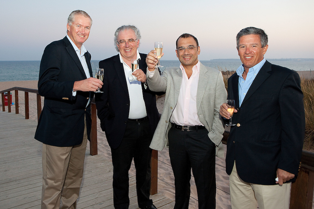 Peter Gilmour, Luis Carito, Patrick Lim, and Justino de Sa Machado enjoy a champagne at a dinner for skippers and VIPs.  Portimao Portugal Match Cup 2010. World Match Racing Tour. Portimao, Portugal. 26 June 2010. Photo: Gareth Cooke/Subzero Images