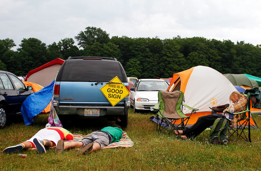 Festival goers rest in the early morning outside their campsite during the 2013 Electric Forest Festival at The Double JJ Ranch in Rothbury Mich., on June 28, 2013.