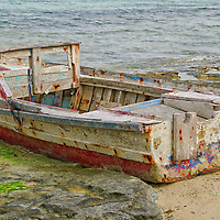 Small boat destroyed on the shoreline