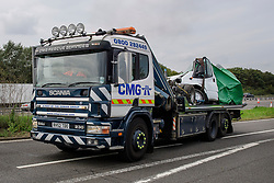 © Licensed to London News Pictures. 26/08/2017. Milton Keynes, UK. Remains of the minibus (right) are removed from the M1 motorway near Milton Keynes. Police say that several people are dead and four others have been taken to hospital after the accident on the southbound carriageway in the early hours of this morning. Photo credit: Ben Cawthra/LNP