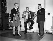 Rory O'Connor (dancing) with Accordion Player (unknown) and DIn Joe/Denis Fitzgibbon (on right) star in Take the Floor.11/04/1957..Popular Irish radio broadcaster of the 1950s Denis ?Din Joe? Fitzgibbon was born in Cork city and educated at the Presentation College. He played rugby for Dolphin and Munster. He studied accountancy and after working for Batchelors Foods in Dublin joined the motor trade with Ford's Smithfield Motors, working his way up to manager of Toyota Ireland in 1975..But his distinctive clear voice blended with a Cork accent was to give him a second career in radio. In the early 1950s he took part in a quiz show with Joe Linane and ?Din Joe? was introduced to the Irish public..By 1953 he was hosting his own recorded radio entertainment show, Take the Floor, the main feature of which was Irish dancing (music supplied by the Garda Ceili Band) but including music, storytelling and humour. His programme, hosted at venues throughout the country, made household names of the Rory O'Connor Dancers (see video below), harpist Kathleen Watkins (later to marry Gay Byrne) and actor Eamonn Keane..Din Joe has gone down in modern Irish lore as the radio host who introduced Irish dancing on radio. His live style was so vivid that it seemed audio-visual. As can been seen in a section of the YouTube video, he also used to call out the moves in the same manner as was done at American barn dances..Apart from Take the Floor, he would go on the host Round the Fire and Can You Beat It?, a series that inspired his book of humour Laughter Unlimited With Din Joe, published by Mercier in 1957. His stories and anecdotes took a wry look at aspects of life at home and abroad..Din Joe knew his strengths and didn't take to television work in the 1966 on a show called Be My Guest and returned to radio. Long after his show ceased in 1978, mere mention of ?Din Joe? or Take the Floor would raise quizzical eyebrows at the mere thought of dancing on the radio..Denis ?Din Joe? Fitzgibbo