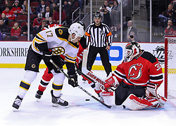 Jan 4, 2012; Newark, NJ, USA; New Jersey Devils goalie Martin Brodeur (30) makes a save on a tip by Boston Bruins left wing Milan Lucic (17) during the first period at the Prudential Center.