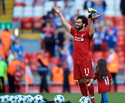 LIVERPOOL, ENGLAND - Sunday, May 13, 2018: Liverpool's Mohamed Salah with the Premier League Golden Boot trophy for finishing the season as the leading League goal-scorer with 32 goals after the FA Premier League match between Liverpool FC and Brighton & Hove Albion FC at Anfield. Liverpool won 4-0 and finished 4th. (Pic by David Rawcliffe/Propaganda)