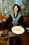 Jimbaran Beach. Waitress Wayan serves her lovingly fried eggs with a smile during breakfast at Keraton Bali Hotel.