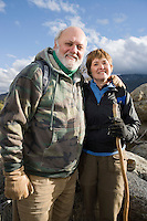 Senior couple embracing in mountains, portrait