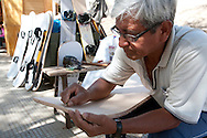 Juan Lengua Salvador has been building and renting sandboards at the oasis of Huacachina in Peru for 19 years.