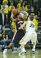 December 04 2010: Idaho State Bengals guard Phyllip Taylor (3) tries to keep the ball away from Iowa Hawkeyes guard Eric May (25) during the second half of their NCAA basketball game at Carver-Hawkeye Arena in Iowa City, Iowa on December 4, 2010. Iowa won 70-53.
