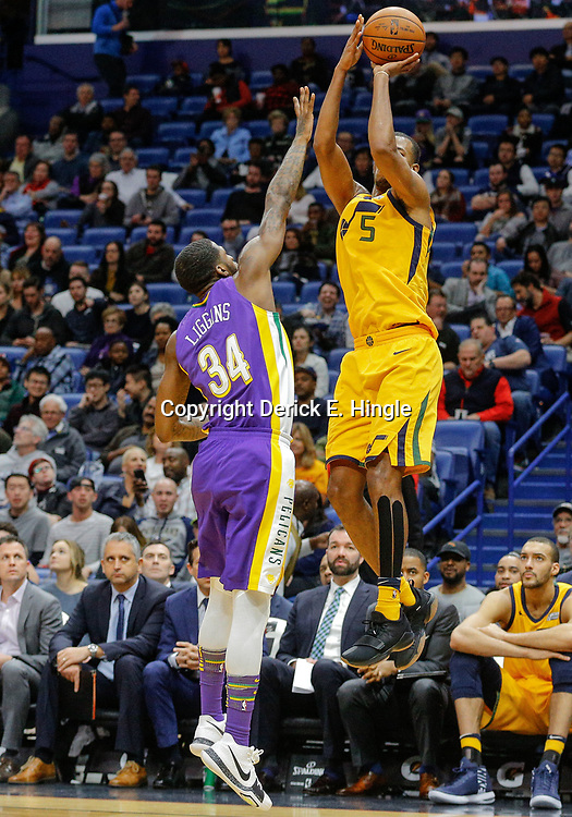 Feb 5, 2018; New Orleans, LA, USA; Utah Jazz guard Rodney Hood (5) shoots over New Orleans Pelicans guard DeAndre Liggins (34) during the second half at the Smoothie King Center. The Jazz defeated the Pelicans 133-109. Mandatory Credit: Derick E. Hingle-USA TODAY Sports