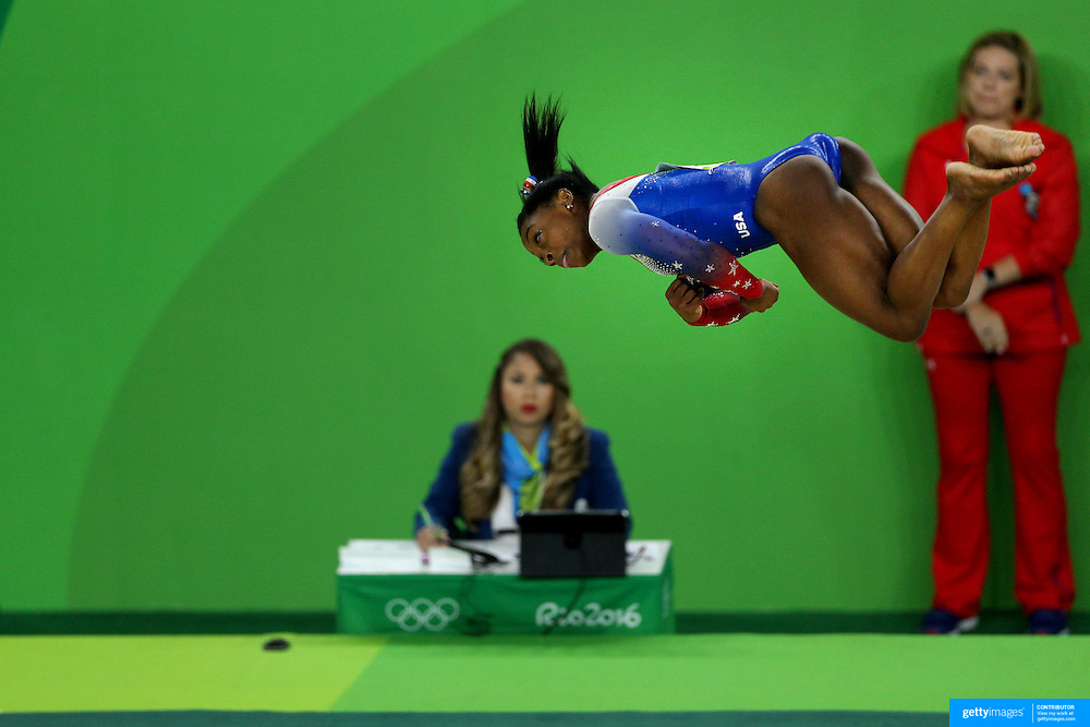 Gymnastics - Olympics: Day 11  Simone Biles of the United States performs her routine on the floor exercise which won her the gold medal during the Apparatus Finals at the Rio Olympic Arena on August 16 , 2016 in Rio de Janeiro, Brazil. (Photo by Tim Clayton/Corbis via Getty Images)