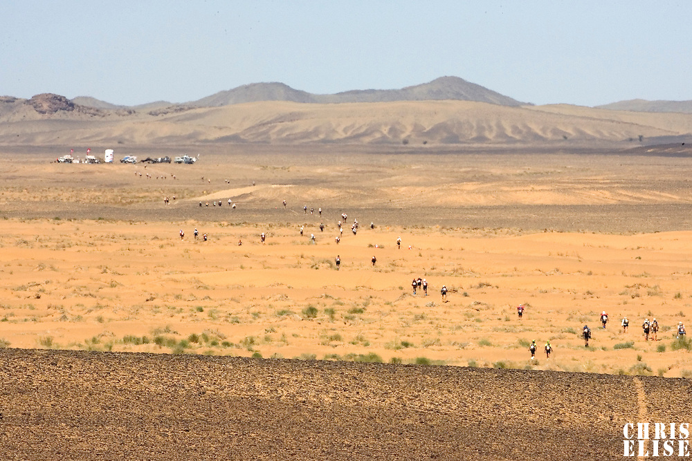 30 March 2007: Participants run toward check point 3 during fifth stage of the 22nd Marathon des Sables between west of Kfiroun and erg Chebbi (26.22 miles). The Marathon des Sables is a 6 days and 151 miles endurance race with food self sufficiency across the Sahara Desert in Morocco. Each participant must carry his, or her, own backpack containing food, sleeping gear and other material.