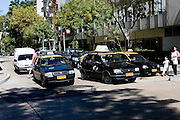 Montevideo, Uruguay - Taxi's wait at an intersection in Montevideo