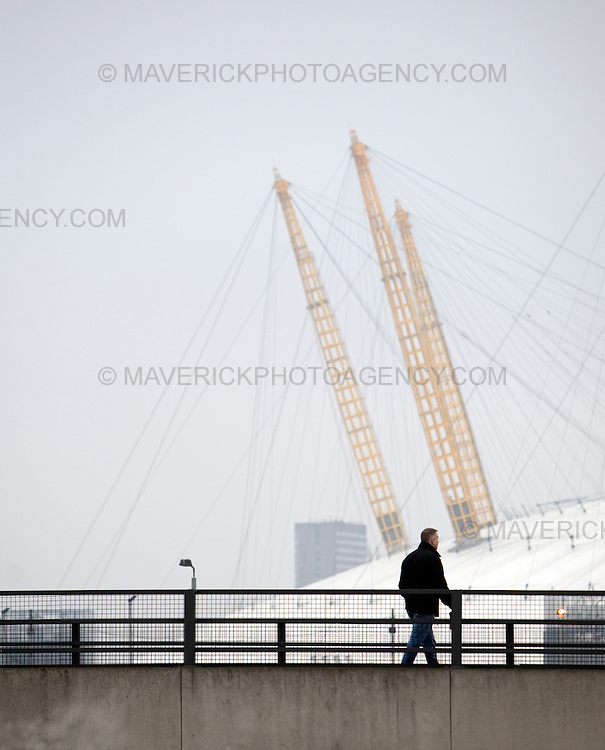 Protesters walk by the 02 centre as they make there way to  the Excel centre in London on the day G20 leaders attend a meeting at the venue..1/4/09.Michael Hughes/Maverick.Tel. 07789681770