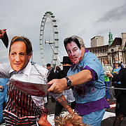 Performers dressed up as David Cameron, Prime Minister and Nick Clegg, Dep Prime Minister chop their way through the crowd, butchering people. The Health and Care Bill has been passed by Parliament and is due to go to the House of Lords. In protest against the bill which aim to deconstruct and privatise large parts of the NHS UK Uncut activists together with health workers and trade unionists blocked the Westminster Bridge from 1pm til 5.30pm.