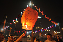 Malaysians of ethnic Chinese release lanterns with messages for the passengers of the missing Malaysia Airlines Boeing 777-200 plane during a vigil for the missing Malaysia Airlines passengers in Kuala Lumpur, March 10, 2014. Malaysia Airlines flight MH370 with 239 people on board went missing early 08 March 2014 while on its way to Beijing, China. Malaysia will expand search and rescue operations to locate the missing Malaysia Airlines passenger jet with 239 people on board, as the third day of searching yielded no results, a senior Malaysian aviation official said,  Monday, 10th March 2014. Picture by Mohd FIrdaus / i-Images