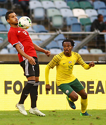 Durban 08-09-18 Mohamed Abdussalami of Libya holds the ball with his chest whilePercy Tau of Bafana Bafanal goes at him during the African Nations qualifier against Libya at Moses Mabhida stedium<br /> Picture Bongani Mbatha African News Agency (ANA)