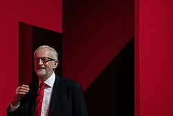 © Licensed to London News Pictures . 24/09/2019. Brighton, UK. Labour leader JEREMY CORBYN emerges from the wings to deliver his speech , brought forward by 24 hours , on the fourth day of the 2019 Labour Party Conference from the Brighton Centre , after the Supreme Court ruled that Boris Johnson's suspension of Parliament was unlawful . Photo credit: Joel Goodman/LNP
