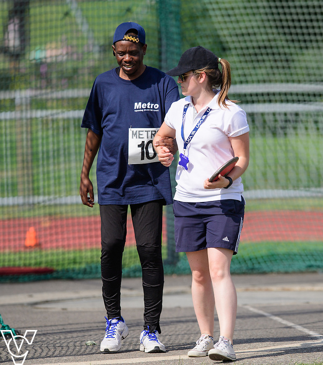 Metro Blind Sport's 2017 Athletics Open held at Mile End Stadium.  Discus.  William Safo with official<br /> <br /> Picture: Chris Vaughan Photography for Metro Blind Sport<br /> Date: June 17, 2017