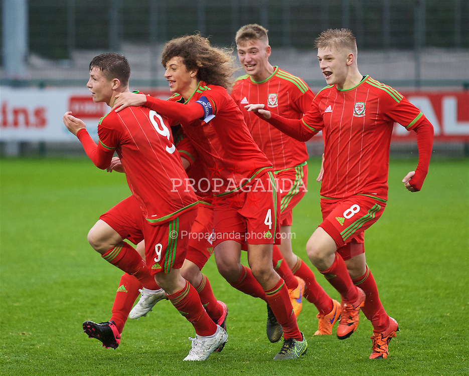 NEWPORT, WALES - Thursday, November 5, 2015: Wales' Steffan Buckeley celebrates after scoring the third goal from the half-way line against Northern Ireland with team-mate Kieron Holsgrove, captain Ethan Ampadu, Ryan Stirk during the Under-16's Victory Shield International match at Dragon Park. (Pic by David Rawcliffe/Propaganda)