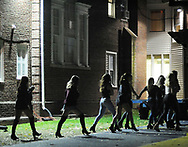 EDITORS PLEASE NOTE: WE WERE ONLY ALLOWED TO IDENTIFY AND SHOW FACES ON THREE OF THE MONITORS AND NOT ALLOWED TO IDENTIFY FRATERNITIES BY NAME: Party goers gather at a fraternity where access to their building was blocked off by barricades in an effort to control the flow of attendees as party monitors check in on fraternities and sororities at Penn State University Sunday, November 12, 2017 in State College, Pennsylvania. (Photo by William Thomas Cain/CAIN IMAGES)