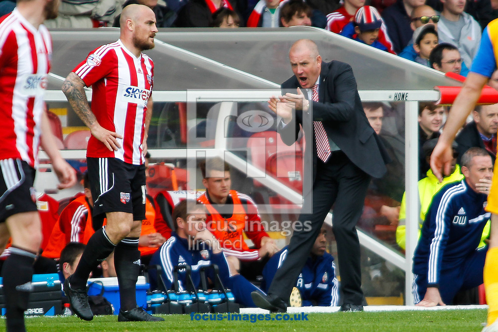 Brentford Manager Mark Warburton during the Sky Bet League 1 match  against Preston North End at Griffin Park, London<br /> Picture by Mark D Fuller/Focus Images Ltd +44 7774 216216<br /> 18/04/2014