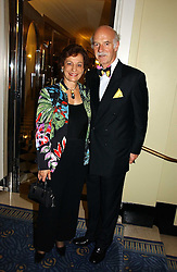 MR & MRS ANTON MOSIMANN at a party hosted by Ruinart Champagne at Claridges, Brook Street, London on 18th October 2006.<br />