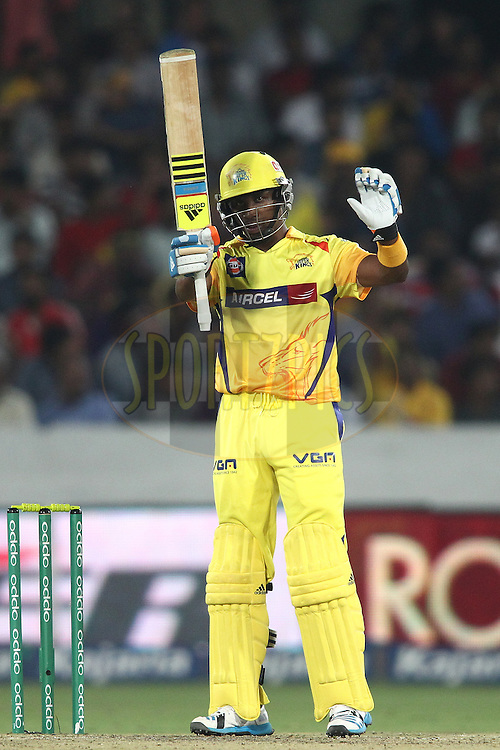 Dwayne Bravo of the Chennai Super Kings raises his bat after reaching his fifty during the second semi final match of the Oppo Champions League Twenty20 between the Kings XI Punjab and the Chennai Superkings held at the Rajiv Gandhi Cricket Stadium, Hyderabad, India on the 2nd October 2014<br /> <br /> Photo by:  Shaun Roy / Sportzpics/ CLT20<br /> <br /> <br /> Image use is subject to the terms and conditions as laid out by the BCCI/ CLT20.  The terms and conditions can be downloaded here:<br /> <br /> http://sportzpics.photoshelter.com/gallery/CLT20-Image-Terms-and-Conditions-2014/G0000IfNJn535VPU/C0000QhhKadWcjYs