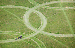 Client LOCOG: Aerial PR shoot - Shire horses mow Olympic rings at Richmond Park. Photo: Anthony Charlton.