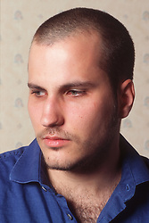 Portrait of young man with shaven head,