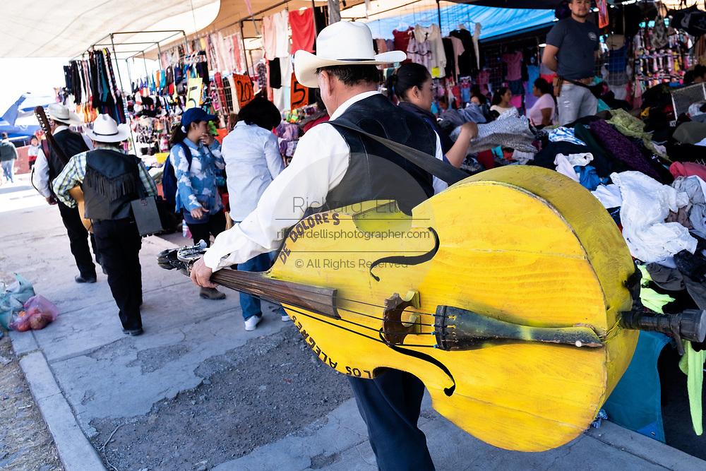 A Mexican mariachi band walks through the Tuesday Market in San Miguel de Allende, Guanajuato, Mexico.