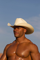 portrait of a muscular African American cowboy outdoors