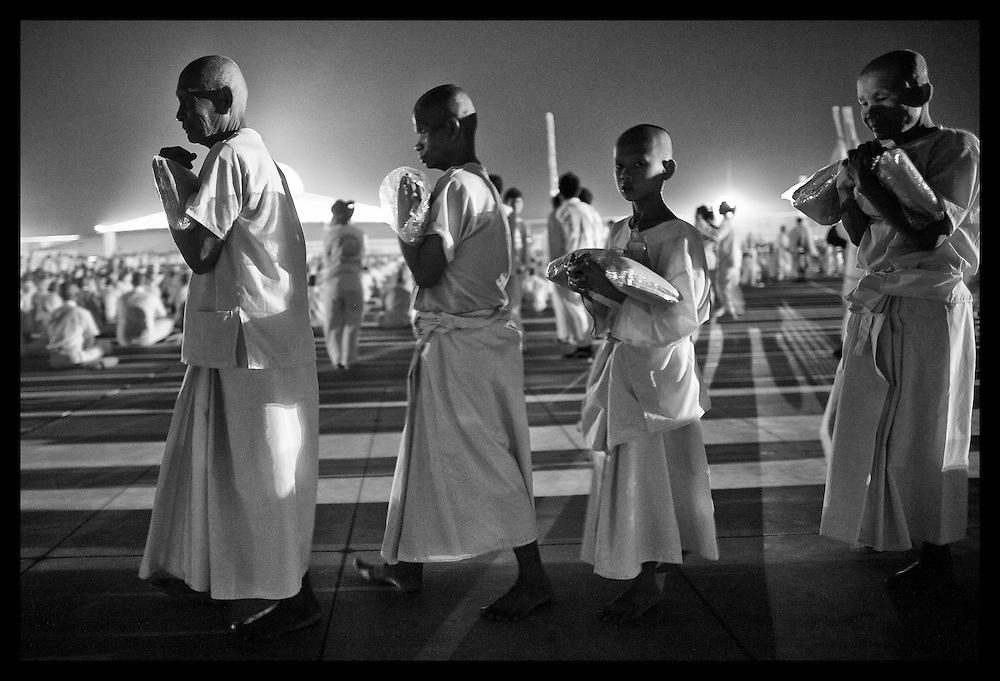 "Buddhist monks during ceremonies Monday, June 4, 2012,  at Wat Dhammakaya on the outskirts of Bangkok, Thailand.  Buddhist monks and the faithful gathered at temples throughout Thailand to celebrate Visakha Bucha or simply ""Vesak"" which is a holiday celebrating the birth,.life, enlightenment, and passing of Gautama Buddha, the founder of.Buddhism."