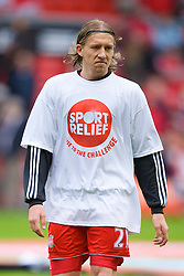 LIVERPOOL, ENGLAND - Saturday, March 8, 2008: Liverpool's Lucas Levia wearing a Sport Relief t-shirt warms up before the Premiership match against Newcastle United at Anfield. (Photo by David Rawcliffe/Propaganda)