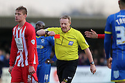 Referee Dean Whitestone shows Ross Etheridge (goalkeeper) of Accrington Stanley FC the red card after handling outside the area during the Sky Bet League 2 match between AFC Wimbledon and Accrington Stanley at the Cherry Red Records Stadium, Kingston, England on 5 March 2016. Photo by Stuart Butcher.