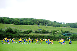 The squad warm up together - Photo mandatory by-line: Dougie Allward/JMP - Tel: Mobile: 07966 386802 24/06/2013 - SPORT - FOOTBALL - Bristol -  Bristol Rovers - Pre Season Training - Npower League Two