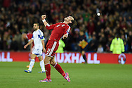 Gareth Bale of Wales celebrates at end of match after the 2-1 win.  Euro 2016 qualifying group B match, Wales v Cyprus at the Cardiff city Stadium in Cardiff, South Wales on Monday 13th Oct 2014.<br /> pic by Andrew Orchard, Andrew Orchard sports photography.