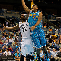 October 9, 2010; New Orleans, LA, USA; New Orleans Hornets guard Marcus Thornton (5) shoots over Memphis Grizzlies shooting guard O.J. Mayo (32) during the second half of a preseason game at the New Orleans Arena.The Grizzlies defeated the Hornets 97-90. Mandatory Credit: Derick E. Hingle